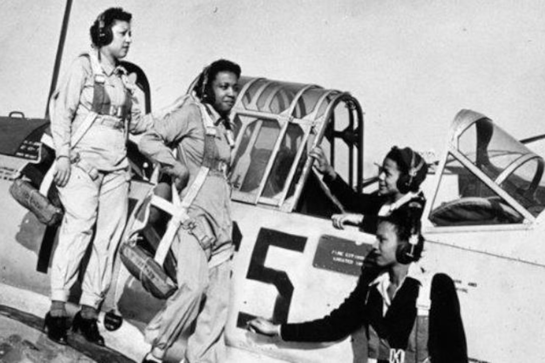 African American nurses exit a plane at Tuskegee Army Air Field, Ala