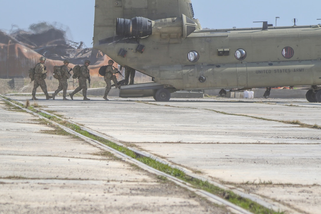 U.S. Army Soldiers deployed in support of Combined Joint Task Force-Operation Inherent Resolve board a U.S. Army CH-47 Chinook helicopter at tactical assembly area Hamam al-Alil, Iraq, Feb. 22, 2017. CJTF-OIR is the global Coalition to defeat ISIS in Iraq and Syria. (U.S. Army photo by Staff Sgt. Jason Hull)