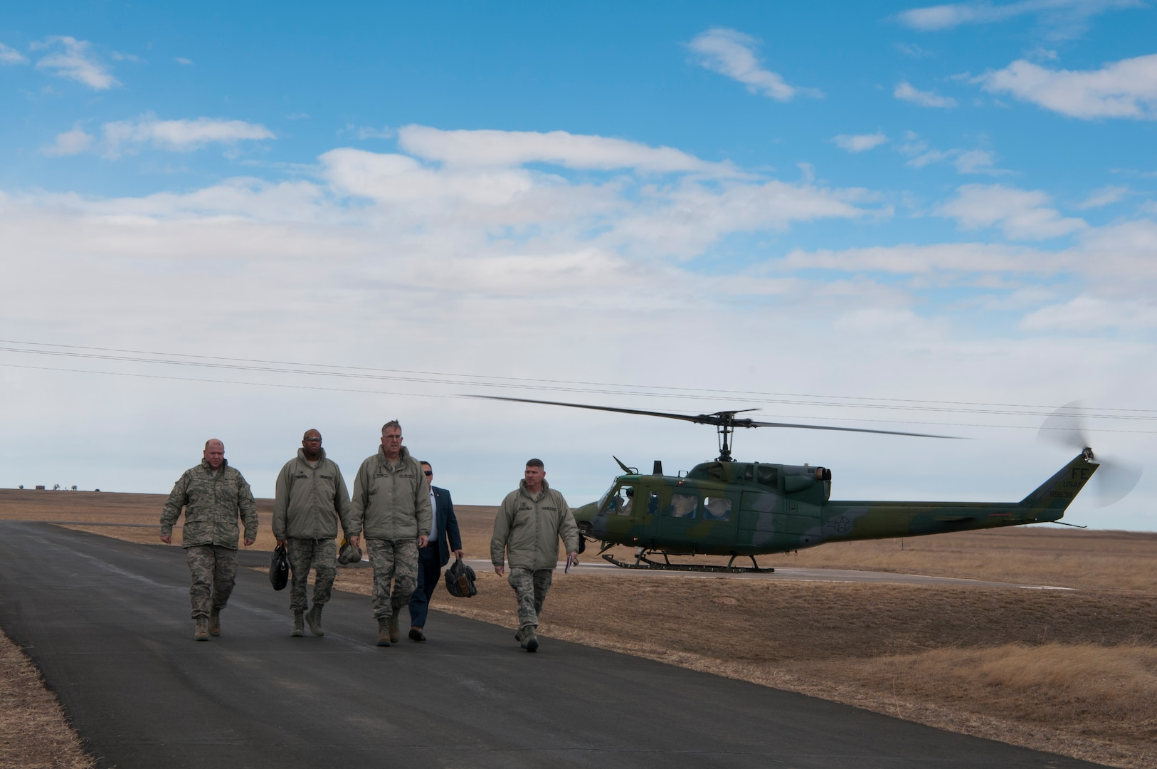 U.S. Air Force Gen. John E. Hyten, U.S. Strategic Command commander, and members of his staff depart a 37th Helicopter Squadron UH-1N Huey near a missile alert facility on the F.E. Warren Air Force Base missile complex, Feb. 22, 2017. Hyten toured the MAF, giving him insight into the responsibilities of the Airmen executing the nation's nuclear deterrence mission. This was Hyten's first visit to the 90th Missile Wing as USSTRATCOM commander.
