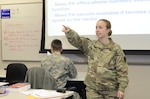 Army Staff Sgt. Heather Denby calls on a student during a Basic Public Affairs Specialist Course class Dec. 16, 2016, at the Defense Information School on Fort Meade, Md. Denby was recognized in November as the school's Warrior of the Quarter for the third quarter of 2016.