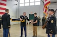 LANCASTER, Pa. - The 3rd Battalion 319th Regiment Command Sgt. Maj. David W. Hausler (left) received help casing the Battalion colors, from his son David Hausler Jr. (right), during the unit's deactivation ceremony held here on Dec. 17, 2016. The ceremony marks the closing of the unit as part of a larger restructuring of the 800th Logistics Support Brigade, headquartered in Mustang, Oklahoma.