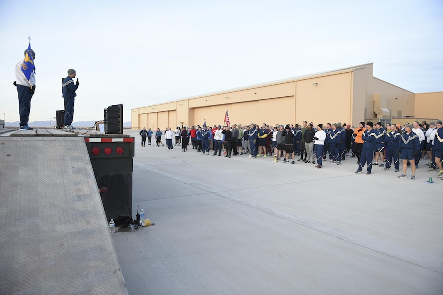 Col. Houston Cantwell, the 49th Wing commander, provides opening remarks during the Proud to be a 49'er Fun Run Jan. 3, 2017 at Holloman Air Force Base to ring in the New Year. The run was held on the flight line with an option to run 1.5 mile or 5K. Participants were encouraged to show their pride by wearing anything that demonstrated their Air Force pride, such as a favorite team jersey or a fun costume. (U.S. Air Force photo by Staff Sgt. Stacy Jonsgaard)