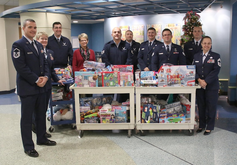 Airmen from the 87th Aerial Port Squadron visit children at the Dayton Children's Hospital giving out toys and holiday cheer December 16, 2016. More than 15 members participated in the unit's 26th annual event. (U.S. Air Force photo/Tech. Sgt. Patrick O'Reilly)