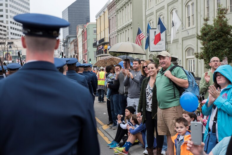 Allstate Sugar Bowl New Years Eve Parade attendees clap and cheer as the U.S. Air Force Honor Guard marches in front of them in New Orleans, LA., Dec. 31, 2016. The parade consisted of floats, bands, marching units and other performers to entertain fans prior to the Allstate Sugar Bowl between the Auburn Tigers and Oklahoma Sooners on Jan. 2, 2017.