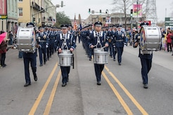 Members of the U.S. Air Force Honor Guard march down a crowd-filled street during the Allstate Sugar Bowl New Years Eve Parade in New Orleans, LA, Dec. 31, 2016.  The event is part of the Allstate Sugar Bowl celebration that leads to the game between the Auburn Tigers and Oklahoma Sooners on Jan. 2., 2017.