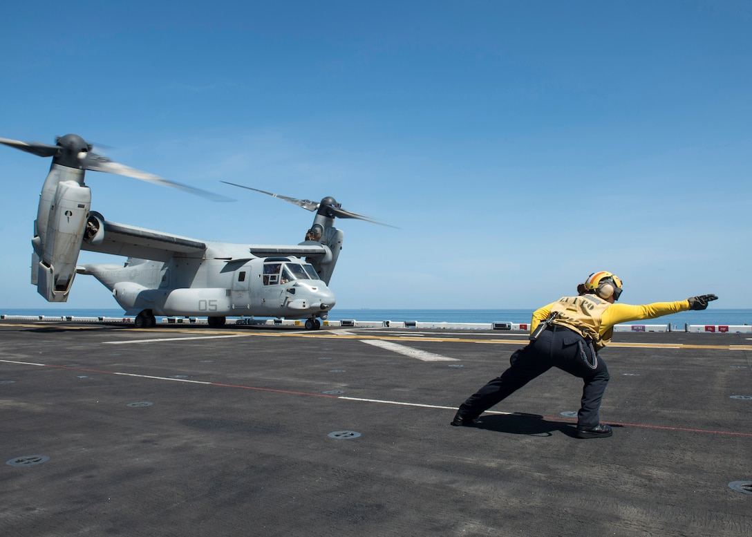 161230-N-LI768-095 GULF OF ADEN (Dec. 30, 2016) Aviation Boatswain's Mate (Handling) 2nd Class Katherine Candie-Anderson, from Nunda, N.Y., signals for an MV-22B Osprey, assigned to the Ridge Runners of Marine Medium Tiltrotor Squadron (VMM) 163 (Reinforced), to take off from the amphibious assault ship USS Makin Island (LHD 8). Makin Island is deployed with the Makin Island Amphibious Ready Group to support maritime security operations and theater security cooperation efforts in the U.S. 5th Fleet area of operations.  (U.S. Navy photo by Mass Communication Specialist 3rd Class Devin M. Langer)