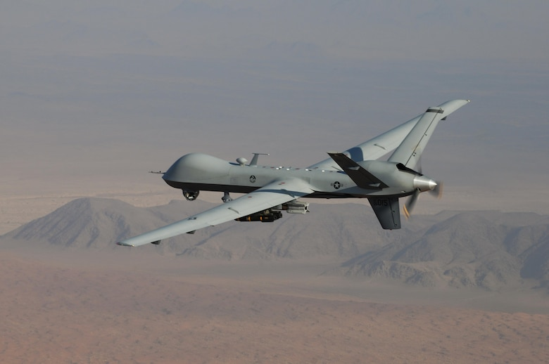 An MQ-9 Reaper, armed with GBU-12 Paveway II laser guided munitions and AGM-114 Hellfire missiles, piloted by Col. Lex Turner flies a combat mission over southern Afghanistan. (U.S. Air Force Photo / Lt. Col. Leslie Pratt)