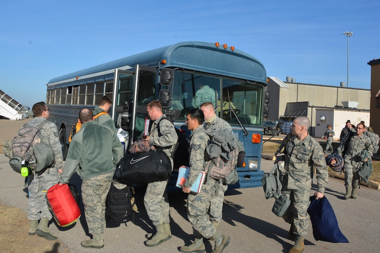 Deploying Citizen Airmen file into the bus to process for a deployment to Incirlik Air Base, Turkey.  Ninety-four 507th Air Refueling Wing Airmen departed to Southwest Asia Dec 12-13, 2016 to support deployed air refueling operations. (U.S. Air Force Photo/Maj. Jon Quinlan)