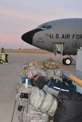 Bags from some of the 94 Reservists from the 507th Air Refueling Wing sit on the flight line prior to being loaded on the KC-135R Stratotanker behind them.  Members of the wing deployed to Incirlik Air Base, Turkey to support air refueling operations in Southwest Asia December 12-13, 2016. (U.S. Air Force Photo/Maj. Jon Quinlan)