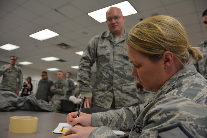 Master Sgt. Angela Vereb, 507th Maintenance Group unit deployment manager scrubs the deployment folder of Staff Sgt. Coty Carter, 507th Aircraft Maintenance Squadron prior to him deploying to Incirlik Air Base, Turkey to support air refueling operations in Southwest Asia December 13, 2016. (U.S. Air Force Photo/Maj. Jon Quinlan)