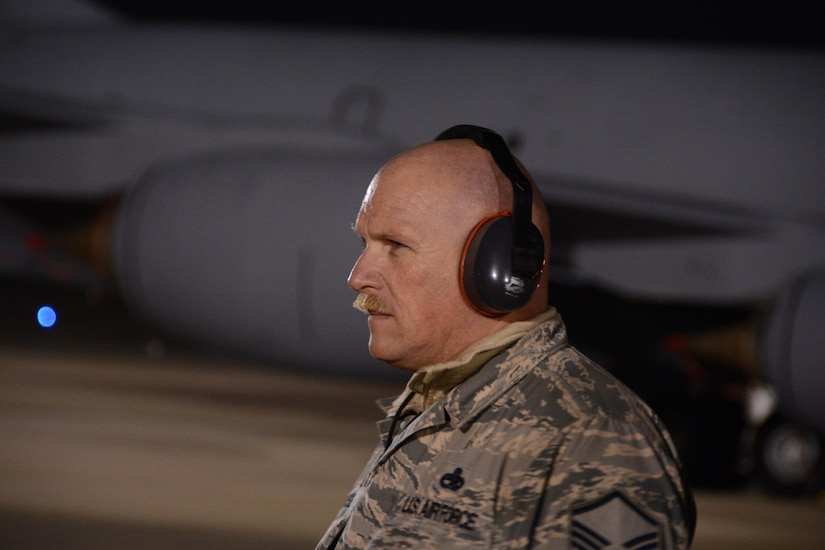 Master Sgt. Jon Russell, 507th Maintenance Squadron Aerospace Group Equipment flight chief, supervises ground operations while two KC-135R Stratotankers packed with cargo and some of the 94 Citizen Airmen launch during a cold December 13th evening at Tinker Air Force Base, Oklahoma.  The two jets deployed to Incirlik Air Base, Turkey to support on-going air refueling operations in Southwest Asia.  (U.S. Air Force Photo/Maj. Jon Quinlan)