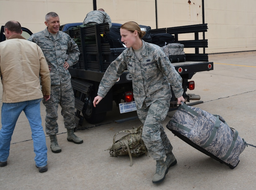 Senior Airman Jenifer Wagoner, 507th Maintenance Group loads her bag into a truck Dec 12, 2016 at Tinker Air Force Base, Oklahoma prior to deploying to Incirlik Air Base, Turkey.  Wagoner is deployed to support maintenance operations as an analyst. (U.S. Air Force Photo/Tech. Sgt. Lauren Gleason)