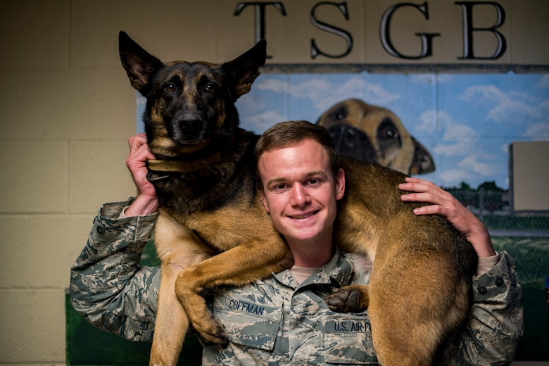 "U.S. Air Force Senior Airman Jacob Coffman, 17th Security Forces Squadron Military Working Dog handler, says his New Year's resolution is to promote and become the best decoy ""bad guy"" in the K9 unit. (U.S. Air Force photo by Senior Airman Devin Boyer/Released)"