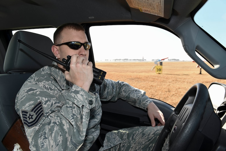 Tech. Sgt. Blake Fagan, 8th Operations Support Squadron aircraft management training noncommissioned officer in charge, uses his radio to call in a noise cannon discharge at Kunsan Air Base, Republic of Korea, Jan. 3, 2017. Fagan is a member of the Bird/wildlife Aircraft Striking Hazard program. He uses a variety of tools from noise cannons and predator calls to shotguns to deter wildlife that could cause significant damage to aircraft. (U.S. Air Force photo by Senior Airman Michael Hunsaker)