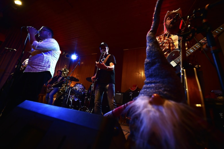 Roll 'N' Rock performs a song during a concert at the Red Barn, Kaiserslautern, Germany, Dec. 17, 2016. Roll 'N' Rock recently took 2nd place in the International Country Music Awards, held at Pullman City, Bavaria. (U.S. Air Force photo by Senior Airman Jonathan Bass)