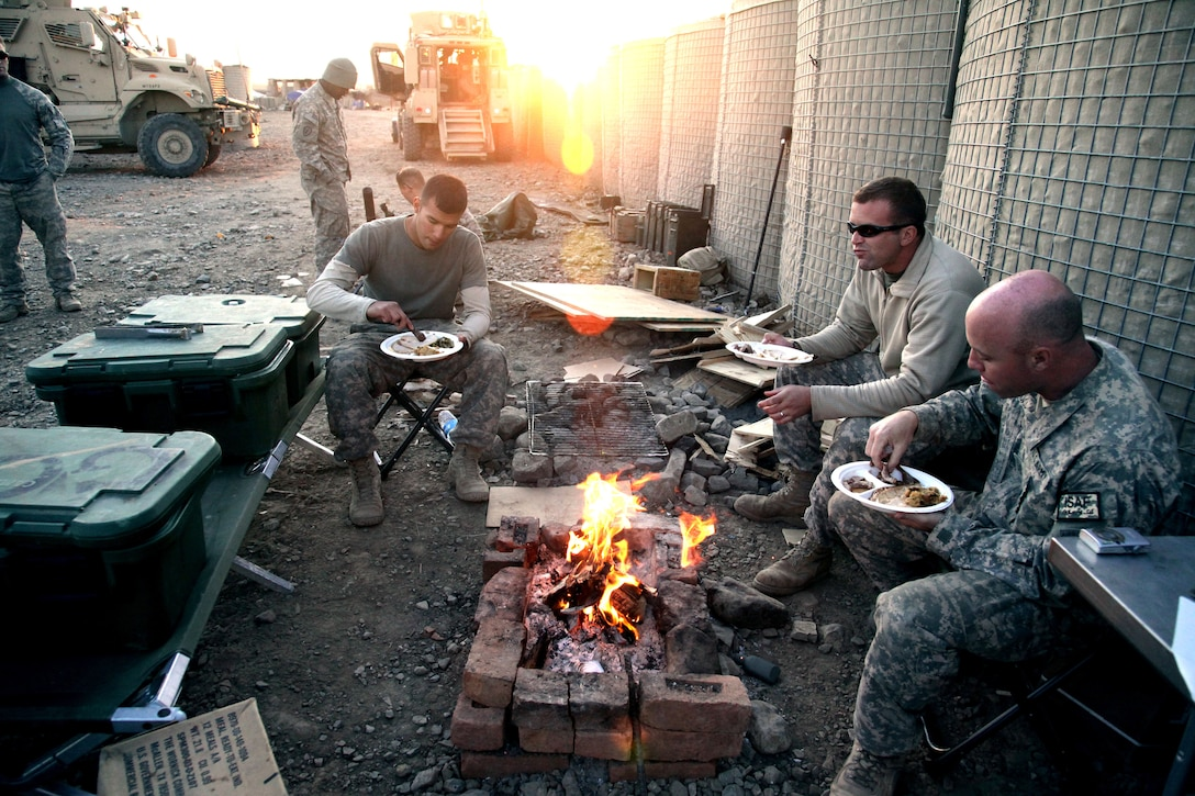 U.S. Army Soldiers eat their Thanksgiving meal on Combat Outpost Cherkatah, Khowst province, Afghanistan, Nov. 26, 2009. The Soldiers are deployed with Company D, 3rd Battalion, 509th Infantry Regiment.