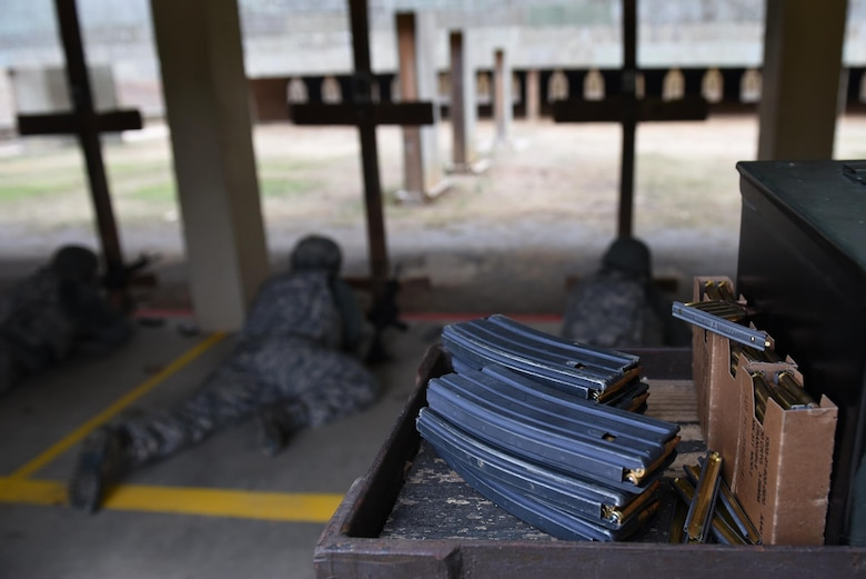 Airmen from the 19th Airlift Wing fire M4 assault rifles during a Combat Arms Training and Maintenance session Dec. 14, 2016, at Little Rock Air Force Base, Ark. The 19th Security Forces Squadron CATM flight taught weapons safety and accountability to more than 650 people last year at Little Rock AFB.  (U.S. Air Force photo by Airman 1st Class Kevin Sommer Giron)