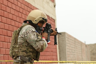 A Panama competitor aims his rifle during an assault team event May 4, 2016 as part of Fuerzas Comando 2016 in Ancon, Peru. Through friendly competition, this exercise promotes military-to-military relationships, increases training knowledge, and improves regional security. (U.S. Army photo by Staff Sgt. Chad Menegay/Released)