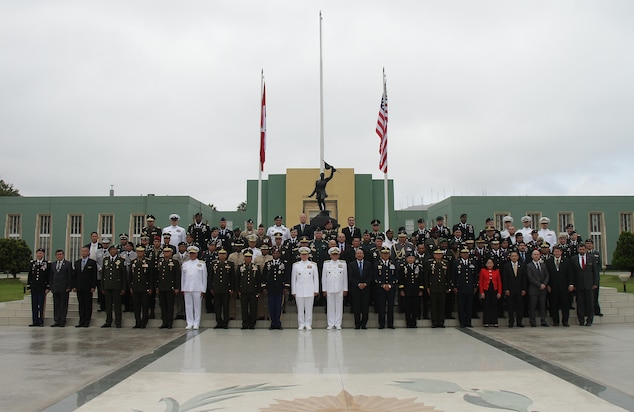 U.S. Navy Adm. Kurt Tidd, commander of U.S. Southern Command, center, joins senior military leaders and government representatives from 20 nations attending the opening ceremony for the Fuerzas Comando 2016 Senior Leader Seminar May 9 at the Chorrillos Military School in Lima, Peru. The three-day seminar includes briefings and discussions on counterterrorism decisions and policymaking, organized crime and illicit trafficking. (Photo by Jose Ruiz)