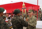 Navy Adm. Kurt W. Tidd, commander of U.S. Southern Command, presents the first place trophy to the Colombia team that won the Fuerzas Comando 2016 competition. Fuerzas Comando is a U.S. Southern Command sponsored multinational special operations skills competition. (Photo by Jose Ruiz, SOUTHCOM Public Affairs)
