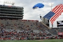 A member from the Wings of Blue, U.S. Air Force Parachute Team, prepares to land on the turf during the 2016 Nova Home Loans Arizona Bowl at the Arizona Stadium in Tucson, Ariz., Dec. 30, 2016. The Wings of Blue performed their demonstration before the start of this year's game, jumping with streamers and flags into the stadium. (U.S. Air Force photo by Senior Airman Ashley N. Steffen)