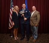 Top Story #1: Senior Airman John Campbell, Special Operations Weather Team student assigned to the Special Tactics Training Squadron, accepts the first Lt. Col. William Schroeder Memorial Award from Abby Schroeder, Schoeder's widow, and John Farris, a SOWT instructor with STTS, at Hurlburt Field, Fla., July 21, 2016. Read more here. (U.S. Air Force photo by Senior Airman Ryan Conroy)