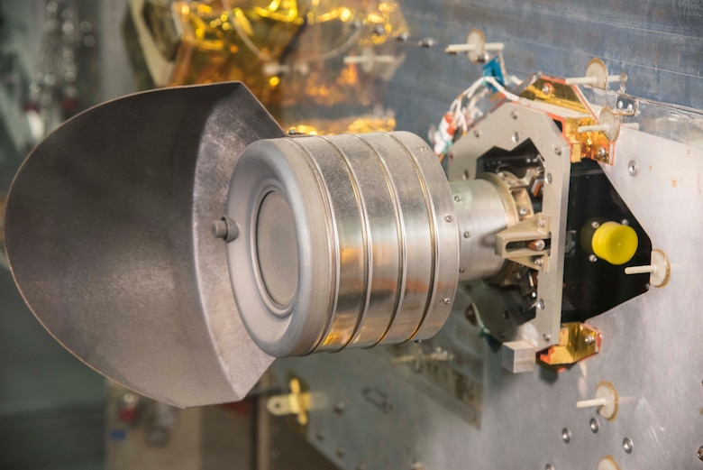 NASA Lewis (now Glenn) Researcher Center in Cleveland, OH, developed this ion thruster to help USAF spacecraft like P80-1 stay precisely positioned in space. The powerful lightweight thruster is electrical instead of a chemical rocket, and is powered by mercury. (U.S. Air Force photo by Ken LaRock)