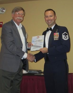 "At right, Master Sgt. Jonathan ""Adam"" Quast receives the 2016 Master Blaster Award recently. The award recognizes an outstanding Air Force active-duty EOD member for his or her achievements and contributions to the unit, base, command and U.S. Air Force EOD program. Quast said he was surprised, appreciative and humbled by the award. (Courtesy photo)"