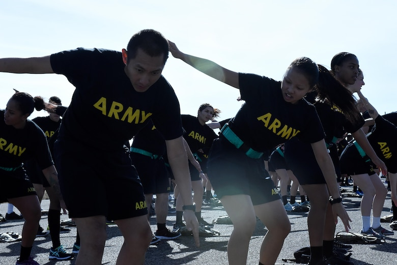U.S. Army 344th Military Intelligence Battalion soldiers warm up before the 17th Training Group formation run on the flightline at Goodfellow Air Force Base, Texas, Jan. 3, 2017. The 17th TRG held the formation run to foster inter-service cooperation and kick off the new year. (U.S. Air Force photo by Airman 1st Class Caelynn Ferguson/ Released)