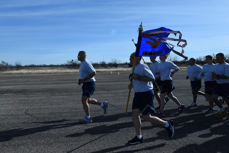 U.S. Air Force Col. Alex Ganster, 17th Training Group Commander, and Chief Master Sgt. Jesus Longoria, 312th Training Squadron superintendent, head the 17th TRG formation run on the flightline at Goodfellow Air Force Base, Texas, Jan. 3, 2017. Participants in the run ranged from TDY students, instructors, 344th Military Intelligence Battalion, 17th Training Support Squadron and 17th TRG permanent party personnel. (U.S. Air Force photo by Airman 1st Class Caelynn Ferguson/ Released)