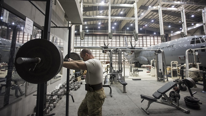 Tech. Sgt. Jason Caswell, the 455th Expeditionary Aircraft Maintenance Squadron C-130 Hercules debrief NCO in charge, prepares to lift weights Jan. 4, 2017, at Bagram Airfield, Afghanistan. Caswell is a wounded warrior deployed on his second back-to-back tour, his first time downrange since losing a leg to a sports injury. (U.S. Air Force photo/Staff Sgt. Katherine Spessa)