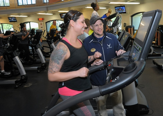 Christian Wasylchak, fitness program manager, assists 2nd Lt. Amanda, 558 Flying Training Squadron remote pilot aircraft student on the treadmill at the Rambler Fitness Center at Joint Base San Antonio-Randolph, Dec. 6, 2016.  Regular exercise or physical activity helps many of the body's systems function better, keeps heart disease, diabetes, and a host of other diseases at bay, and is a key ingredient for losing weight. Exercising will not only increase your strength and tone, but will also increase your metabolism.