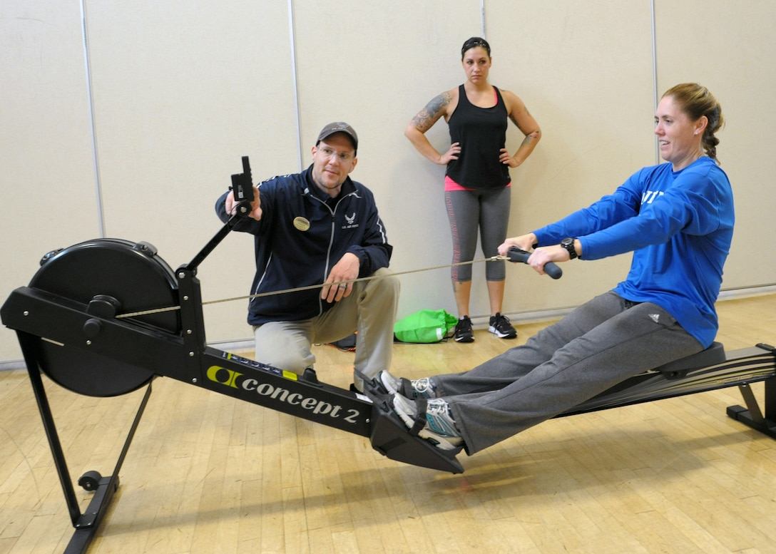 Christian Wasylchak, fitness program manager, assists 2nd Lt. Rebecca, 558 Flying Training Squadron remote piloted aircraft student, on the rowing machine at the Rambler Fitness Center at Joint Base San Antonio-Randolph, Dec. 6, 2016. There are 11 fitness centers throughout JBSA providing strength and conditioning equipment from weights to cardio and classes from aerobics to Taekwondo. The fitness centers are free to Department of Defense cardholders, including active-duty, Reserve and National Guard members, military family members, military retirees and government civilians.