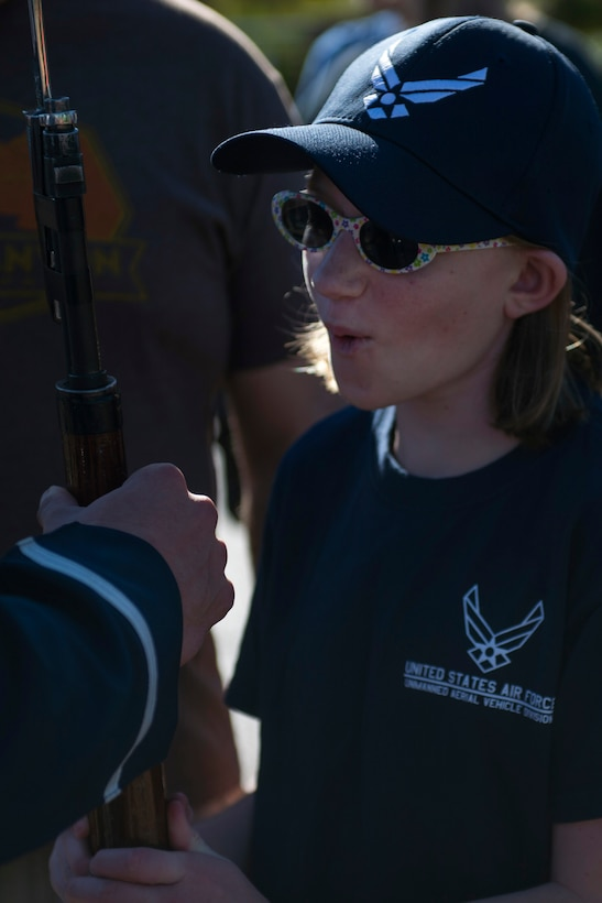 A Sea World guest holds a U.S. Air Force Honor Guard Drill Team drill rifle after a performance in San Diego, Calif., Dec. 29, 2016. The drill team showcases their drill performances at public venues, such as Sea World, to recruit and inspire the public. (U.S. Air Force photo by Senior Airman Philip Bryant)