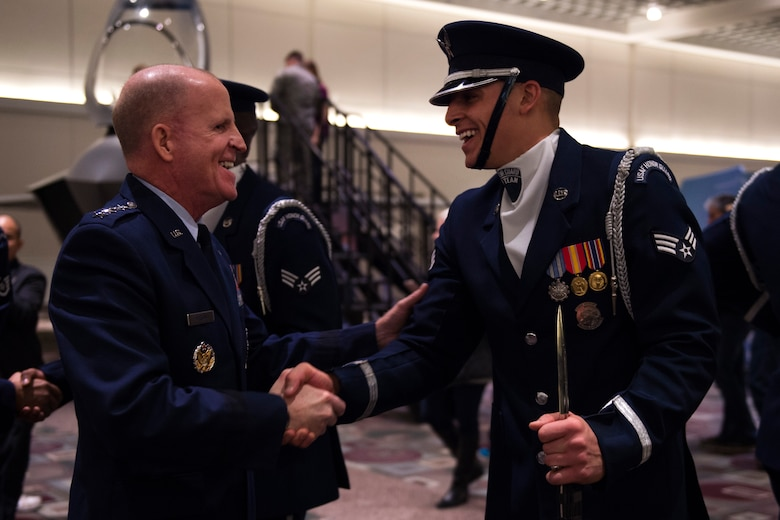 Vice Chief of Staff of the Air Force Gen. Stephen W. Wilson, left, shakes hands with Senior Airman Angelo Hightower, U.S. Air Force Honor Guard Drill Team member, after a performance at the Live on Green event in Pasadena, Calif., Dec. 30, 2016. The drill team spent five days in southern California to help kick off the year-long celebration of the Air Force's 70th Birthday. (U.S. Air Force photo by Senior Airman Philip Bryant)