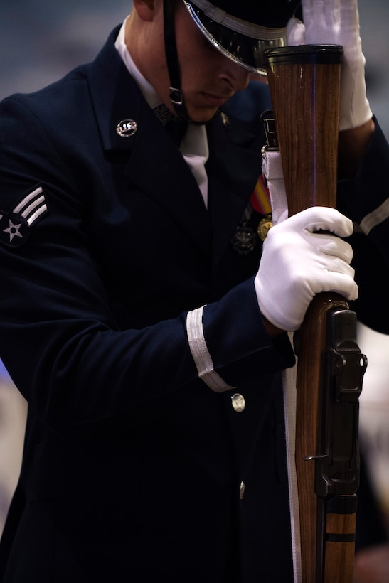 Senior Airman Angelo Hightower, U.S. Air Force Honor Guard Drill Team member, performs a rifle maneuver at the Live on Green event in Pasadena, Calif., Dec. 31, 2016. The Live on Green event is held annually as a celebration leading up to the Rose Parade and Rose Bowl Game. (U.S. Air Force photo by Senior Airman Philip Bryant)