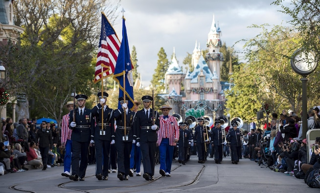 U.S. Air Force Honor Guard Drill Team members and the Air Force Total Force Band march along Disneyland's main street in Anaheim, Calif., Jan. 1, 2017. The drill team spent five days in southern California to help kick off the year-long celebration of the Air Force's 70th Birthday. (U.S. Air Force photo by Senior Airman Philip Bryant)
