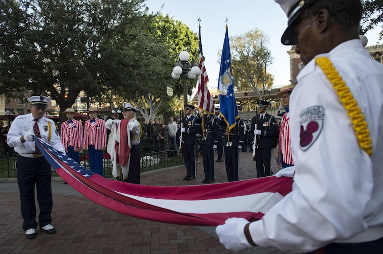 U.S. Air Force Honor Guard Drill Team members present the colors during a retreat ceremony at Disneyland in Anaheim, Calif., Jan. 1, 2017. The Honor Guard took part in Disneyland's daily retreat ceremony, where the National Anthem is sung, the flag is folded and service members in the crowd from all branches are recognized. (U.S. Air Force photo by Senior Airman Philip Bryant)