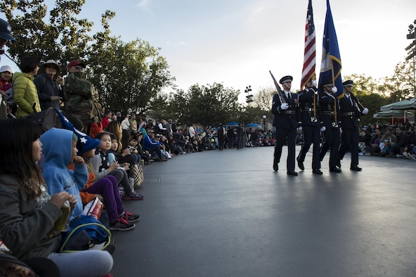 U.S. Air Force Honor Guard Drill Team members march past Disneyland guests in Anaheim, Calif., Jan. 1, 2017. Disneyland had approximately 44,000 guests lining the park's streets as they marched. (U.S. Air Force photo by Senior Airman Philip Bryant)