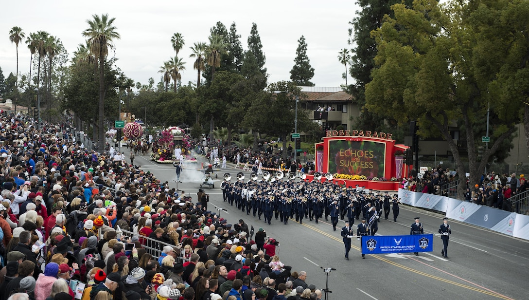 U.S. Air Force Honor Guard Drill Team members and the Air Force Total Force Band march in the 128th Rose Parade in Pasadena, Calif., Jan. 2, 2017. The Honor Guard and Total Force Band represented the Air Force in front of approximately one million spectators to kick off a year-long celebration of the Air Force's 70th Birthday. (U.S. Air Force photo by Senior Airman Philip Bryant)