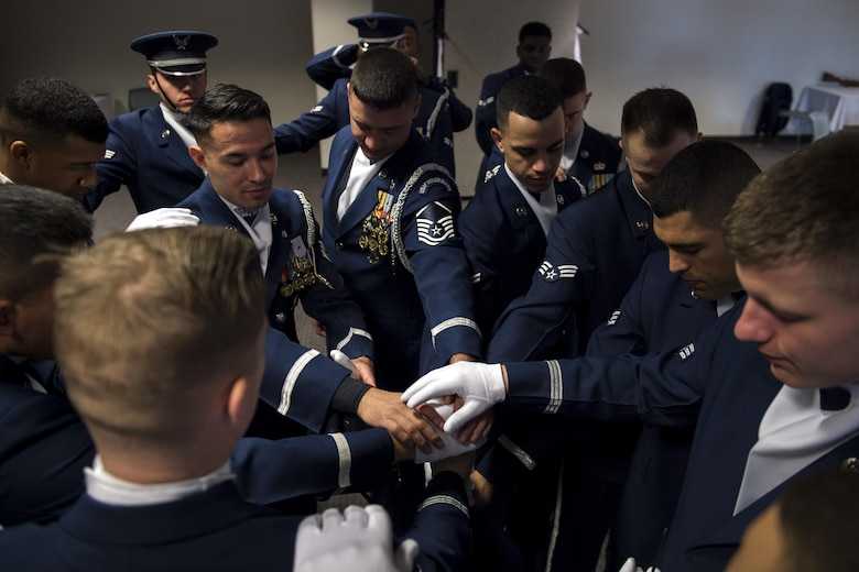 U.S. Air Force Honor Guard Drill Team members pray before a performance at the Live on Green event in Pasadena, Calif., Jan. 1, 2017.Drill team members come together and pray as part of their pre-drill ritual before every performance. (U.S. Air Force photo by Senior Airman Philip Bryant)
