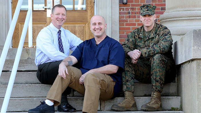 Joseph Klocek (left) and Maj. Scott Graniero (right) pose with Master Sgt. Clifford Farmer at Marine Corps Systems Command aboard Marine Corps Base Quantico, Va. Farmer credits the support and compassion of the two men—part of his leadership team at MCSC—with saving his life during a time when he contemplated suicide. Today, Farmer battles post-traumatic stress disorder and depression, and urges leaders across the Marine Corps to show understanding and compassion for Marines who may be suffering. (U.S. Marine Corps photo by Monique Randolph)