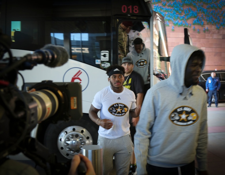 A group of High-school athletes from the U.S. Army All-American Bowl east and west teams step off a bus in front of the University Hospital in San Antonio before visiting sick and injured children as part of a community relations event.  The athletes and their Soldier mentors are in town preparing for the All-American Bowl game on Jan. 7.  For 16 years the Bowl has been the nation's premier high school football game, serving as the preeminent launching pad for America's future college and National Football League stars. (Photo by U.S. Army Reserve Sgt. 1st Class Brent C. Powell)