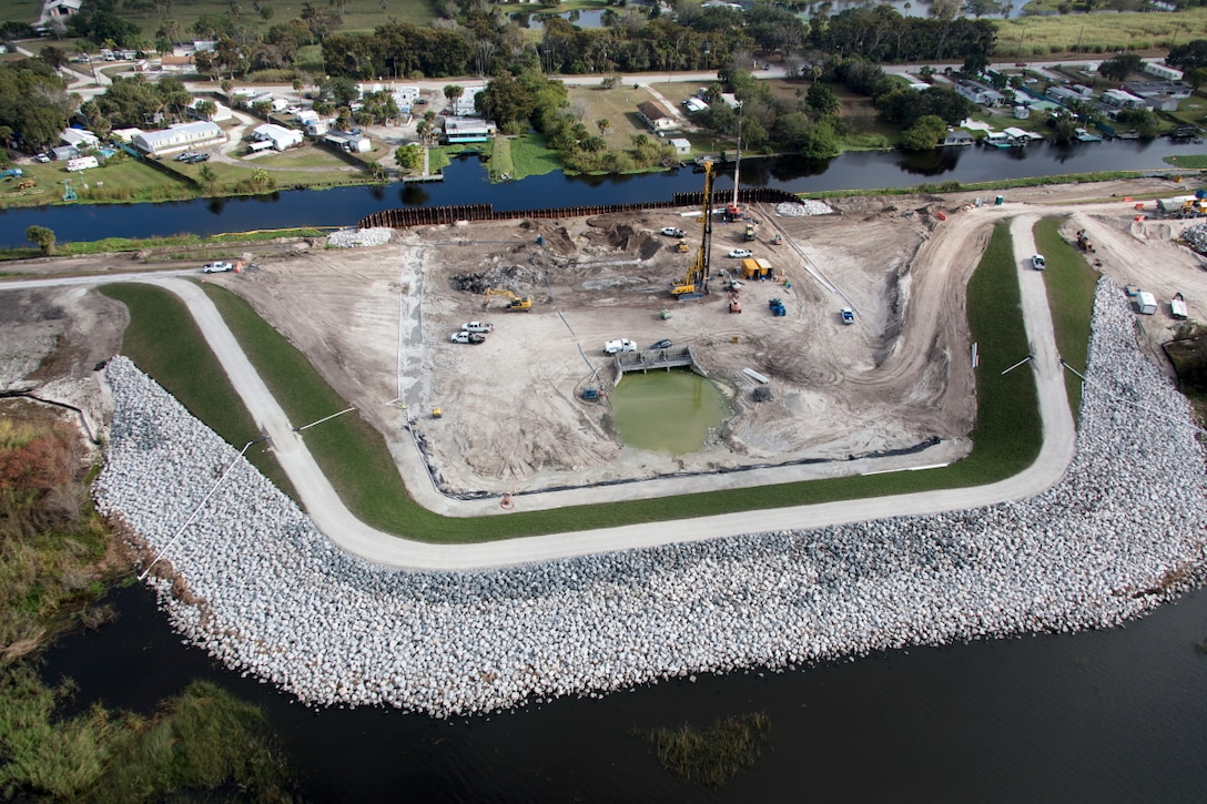 With a cofferdam in place (foreground), crews work to excavate material from Herbert Hoover Dike at the Culvert 8 work site near the city of Okeechobee. Culvert 8 is one of 28 water control structures the U.S. Army Corps of Engineers is replacing as part of its efforts to rehabilitate the dike that surrounds Lake Okeechobee.