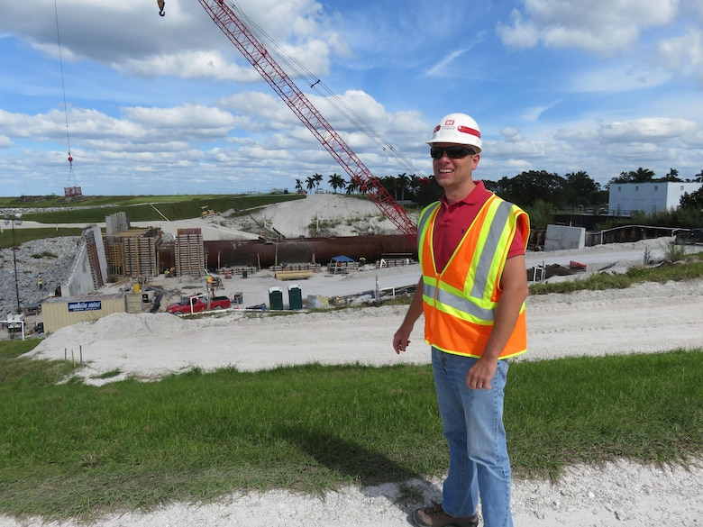 """Herbert Hoover Dike rehabilitation program manager Mike Rogalski pauses for a question while observing work at the Culvert 12 job site near Pahokee. The U.S. Army Corps of Engineers is replacing more than two dozen water control structures, commonly known as """"culverts"""" to reduce risk of failure of the 143-mile earthen dike that surrounds Lake Okeechobee in south Florida."""