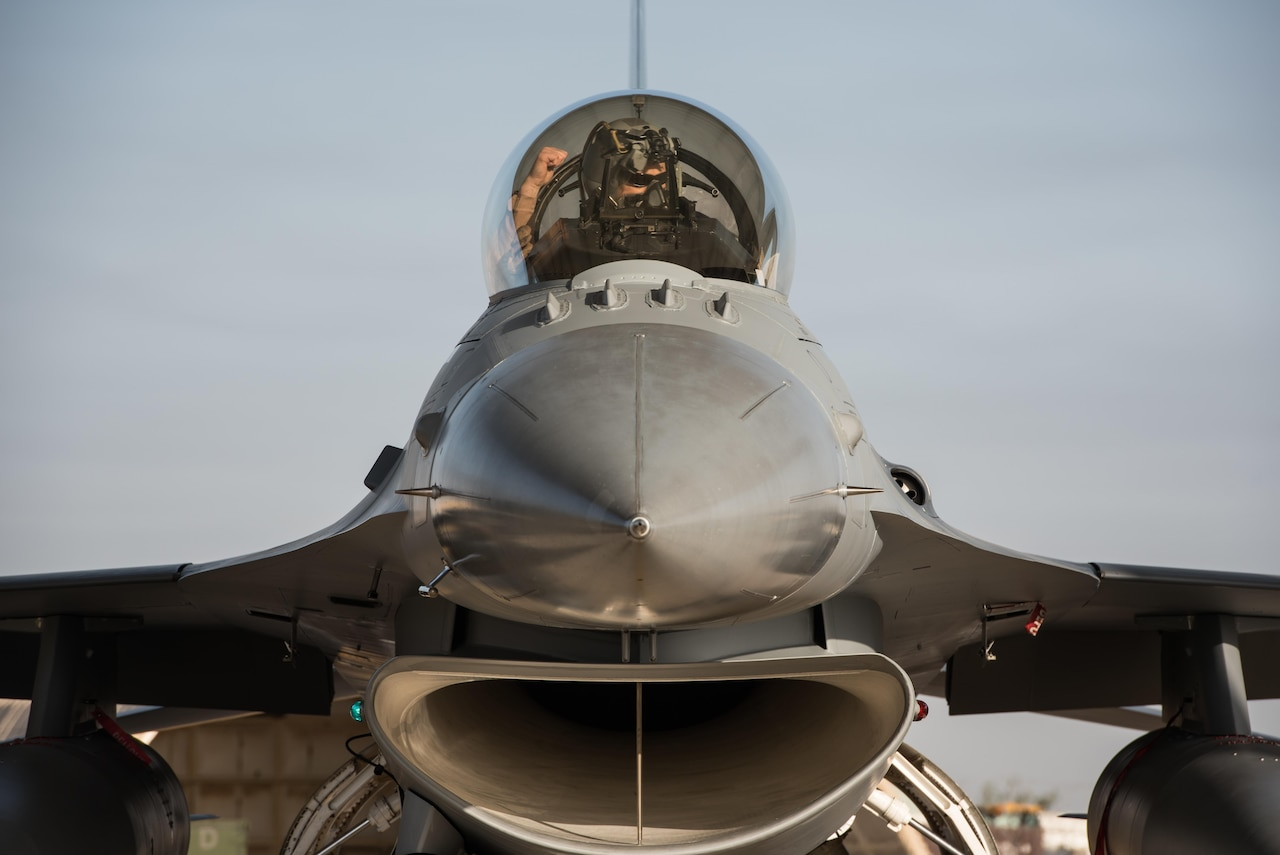 An F-16 Fighting Falcon pilot assigned to the 134th Expeditionary Fighter Squadron performs preflight checks at the 407th Air Expeditionary Group, Dec. 29, 2016. The 134th EFS is flying combat missions for Operation Inherent Resolve to support and enable Iraqi Security Forces' efforts with the unique capabilities provided by the fighter squadron. (U.S. Air Force photo/Master Sgt. Benjamin Wilson)(Released)