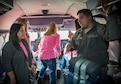 Senior Airman Rolando Gomez, 433rd Aircraft Maintenance Squadron hydrolic technician, explains his job to Lisa Haar, Air Force Wing Moms founder, during a C-5M Super Galaxy tour Jan. 5, 2017 at Joint Base San Antonio-Lackland,Texas. The AFWM's mission is to provide support to family members and friends of trainees who are  experiencing Air Force Basic Military Training. (U.S. Air Force photo by Benjamin Faske)