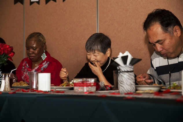 Hitomi Yamaguchi, a logistics-contractor specialist, laughs and reminisces with her friends at her retirement ceremony at Marine Corps Air Station Iwakuni, Japan, Dec. 16, 2016. Yamaguchi started working on the air station in 1974 and held four jobs during her 42 years of service as a stock control clerk, voucher examiner, and an administrator specialist.  However, she spent most of her time as a logistics-contractor specialist.   (U.S. Marine Corps photo by Lance Cpl. Gabriela Garcia-Herrera)