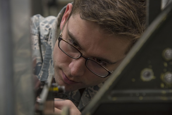 U.S. Air Force Staff Sgt. Jeffery Tyler, a 35th Maintenance Group physical dimension NCO in charge, measures the distance between two areas on a boresight fixture at Misawa Air Base, Japan, Nov. 2, 2016. Boresight is a method of adjustment, which an optical firearm sight to aligns the firearm barrel with the sight, ensuring the weapon hits targets. (U.S. Air Force photo by Airman 1st Class Sadie Colbert)