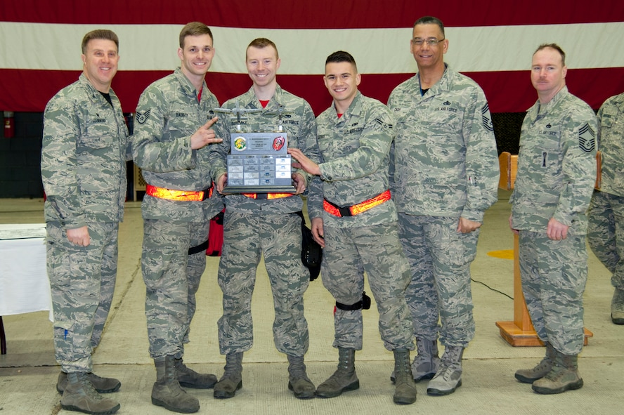 Leadership from the 51st Maintenance Group present the 4th Quarter Weapons Load Crew of the Quarter Award to Staff Sgt. Adam Badgley, Staff Sgt. Christopher Schimke and Airman 1st Class Niko Kornau at Osan Air Base, Republic of Korea, Jan. 6, 2017. The 36th Aircraft Maintenance Unit won the award for reloading munitions on their respective aircraft the quickest and safest. (U.S. Air Force photo by Staff Sgt. Jonathan Steffen)